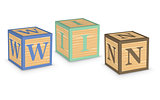 Word WIN written with alphabet blocks