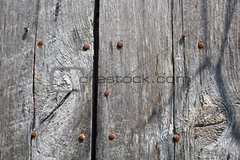 Aged Wood and Rusty Bolts Background