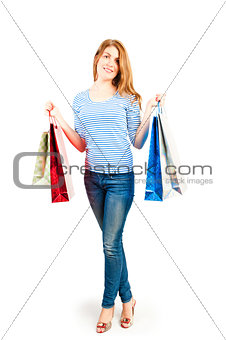 beautiful girl on a white background holding shopping bags