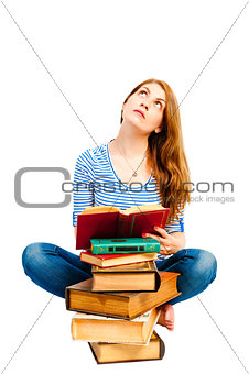thoughtful student and pile of books