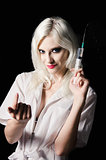 Smiling beautiful young woman in the image of nurse with syringe