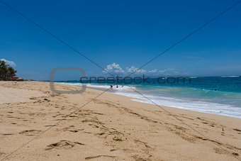 Beautiful tropical beach with lush vegetation