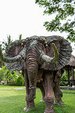 Elephant statue standing on a lawn at a park