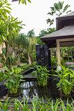 Ornate column in formal Balinese garden