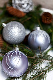 Silver Christmas ornaments in leaves