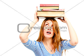 beautiful girl student with books on her head