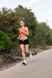 Fit young woman jogging