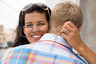 Beautiful radiant woman hugging her boyfriend