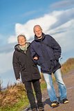 happy mature couple relaxing baltic sea dunes