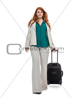 Business woman carrying luggage