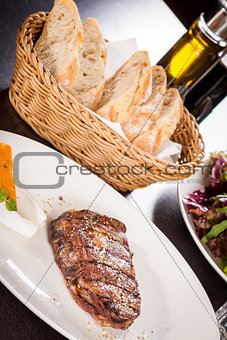 Grilled beef steak with seasoning
