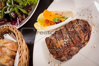 Grilled beef steak with seasoning