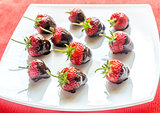 Fresh strawberries covered with dark chocolate