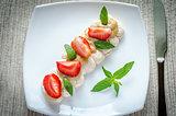 Meringue cake with cream and fresh strawberries