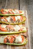 Stuffed zucchini on the wooden board