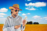 Farmer with cowboy straw hat in wheat field