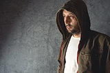 Man wearing jacket with hoodie