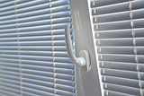 Venetian blinds on window