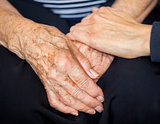 Young hand consoling old hands