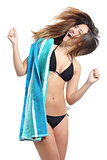 Funny sunbather girl wearing bikini and towel ready for vacations