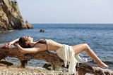 Sunbather beautiful woman sunbathing on the beach