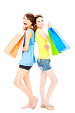 happy and smiling  young women with shopping bags