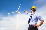 young engineer standing and point to wind generator