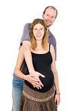 Happy man embracing beautiful pregnant woman isolated