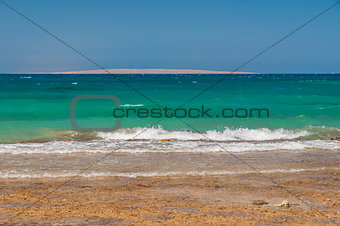 Beautiful azure red sea with waves and rocks in Egypt
