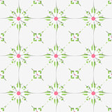 White tile ornament with pink and green