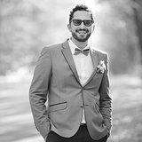 Happy groom on wedding day posing.