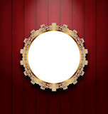 Ornate picture frame on wooden wall