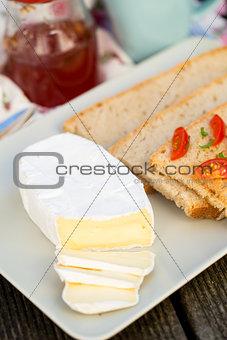 Sliced camembert cheese