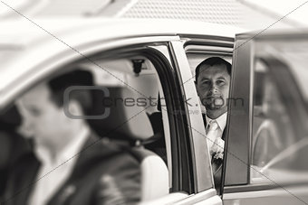 groom sitting in a car