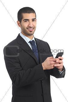 Arab businessman using a smartphone and looking at camera