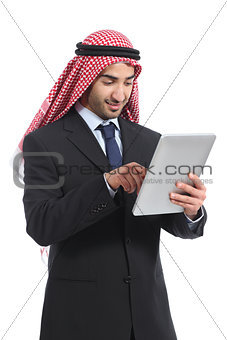 Arab saudi emirates businessman working with a tablet reader