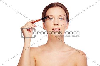 Applying eyeshadows