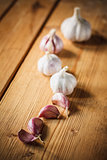 Raw garlic on wooden background