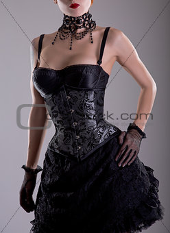 Elegant young woman in silver corset