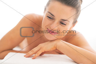 Portrait of relaxed young woman laying on massage table