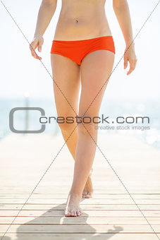 Closeup on young woman walking on bridge