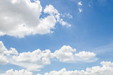 Puffy clouds and blue sky in sunny day
