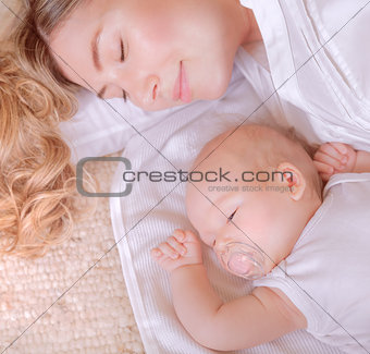 Little baby with mother sleep