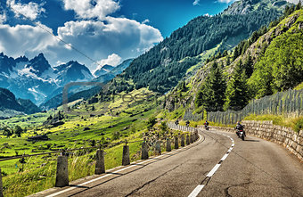 Group of bikers touring European Alps