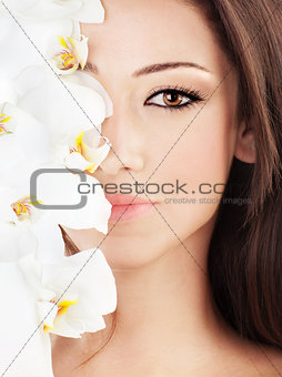Closeup on beautiful face with flowers