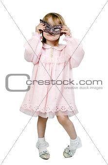 little girl in a fancy mask in studio