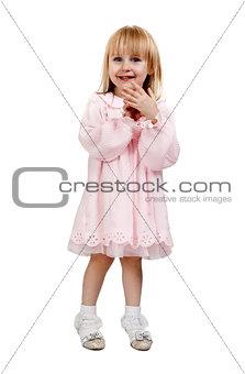 little girl in a pink dress in studio