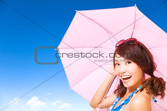 beauty young woman holding a umbrella with blue sky
