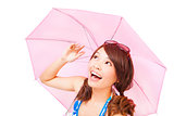 happy young woman holding a umbrella