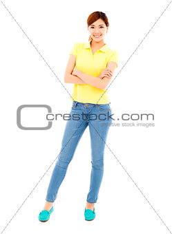 happy young woman standing and cross her arms